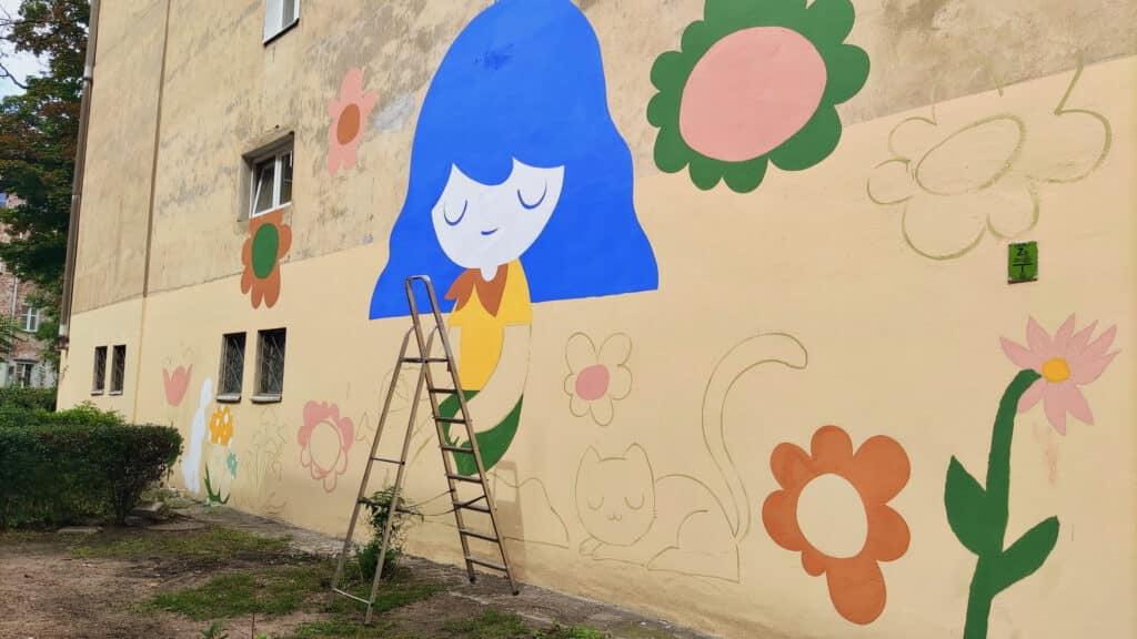 Eko mural malowany pod okiem Jimena Caamano - Pum Pum w ramach BraveKids2021 farbami antysmogowymi KNOxOUT